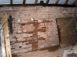 Repairs to the cracked wall in the hay-loft
