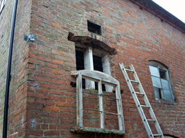 Gently lowering a window frame