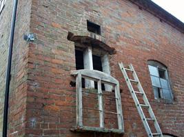 Gently lowering a window frame