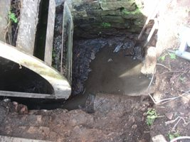 The wheel pit and drain as we found it