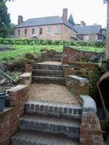 Steps past the waterwheel