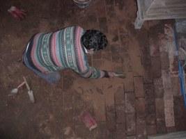 Max re-lays the block floor.