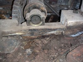 The main bearing resting on rotten timber.