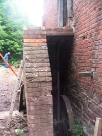 Newly chamfered bricks in the hay-loft steps
