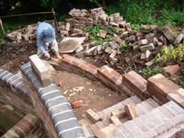 Curved brick wall under construction