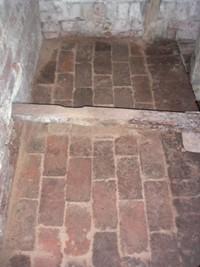 Brick flooring under the PTO shaft.