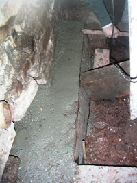 Another section of concrete underpinning