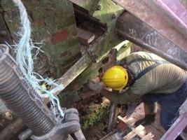 Dave works around the waterwheel.