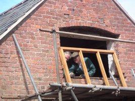 Installing a hardwood window frame.